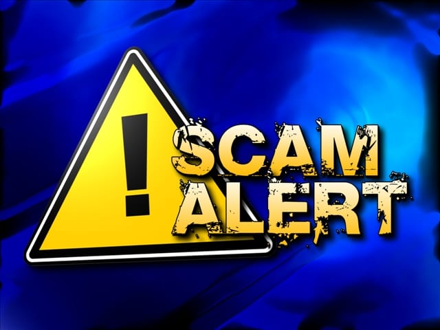 The Words Scam Alert and a Triangular Yellow Sign with a Black Exclamation Point on a Blue Background