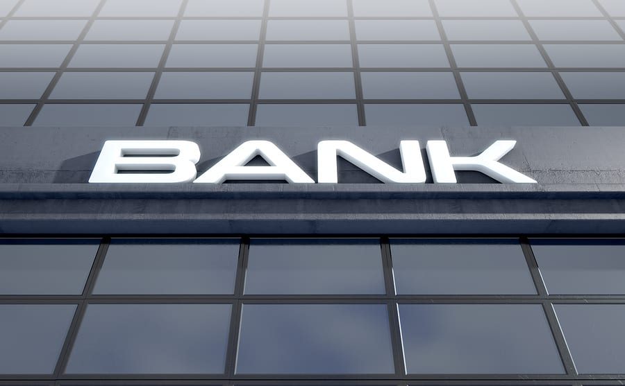Orange COunty foreclosure attorney - Banking light box signage above the entrance to a modern glass bank building in the day time - 3D render