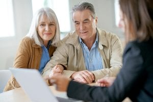 Orange County will lawyer - Senior couple meeting financial adviser for investment