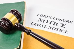 Los Angeles foreclosure defense attorney - Gavel and Foreclosure Notice document with old book.