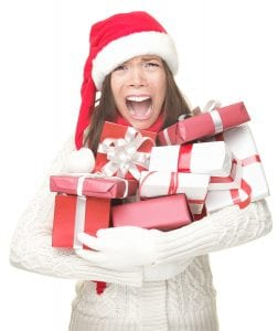 Los Angeles bankruptcy lawyer - Christmas holidays shopping woman stress. Shopper holding christmas gifts stressed frustrated and screaming angry. Funny image of Asian / caucasian woman in santa hat and arms full of gifts. Isolated on white background.