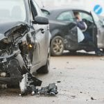 car crash accident on street, damaged automobiles after collision