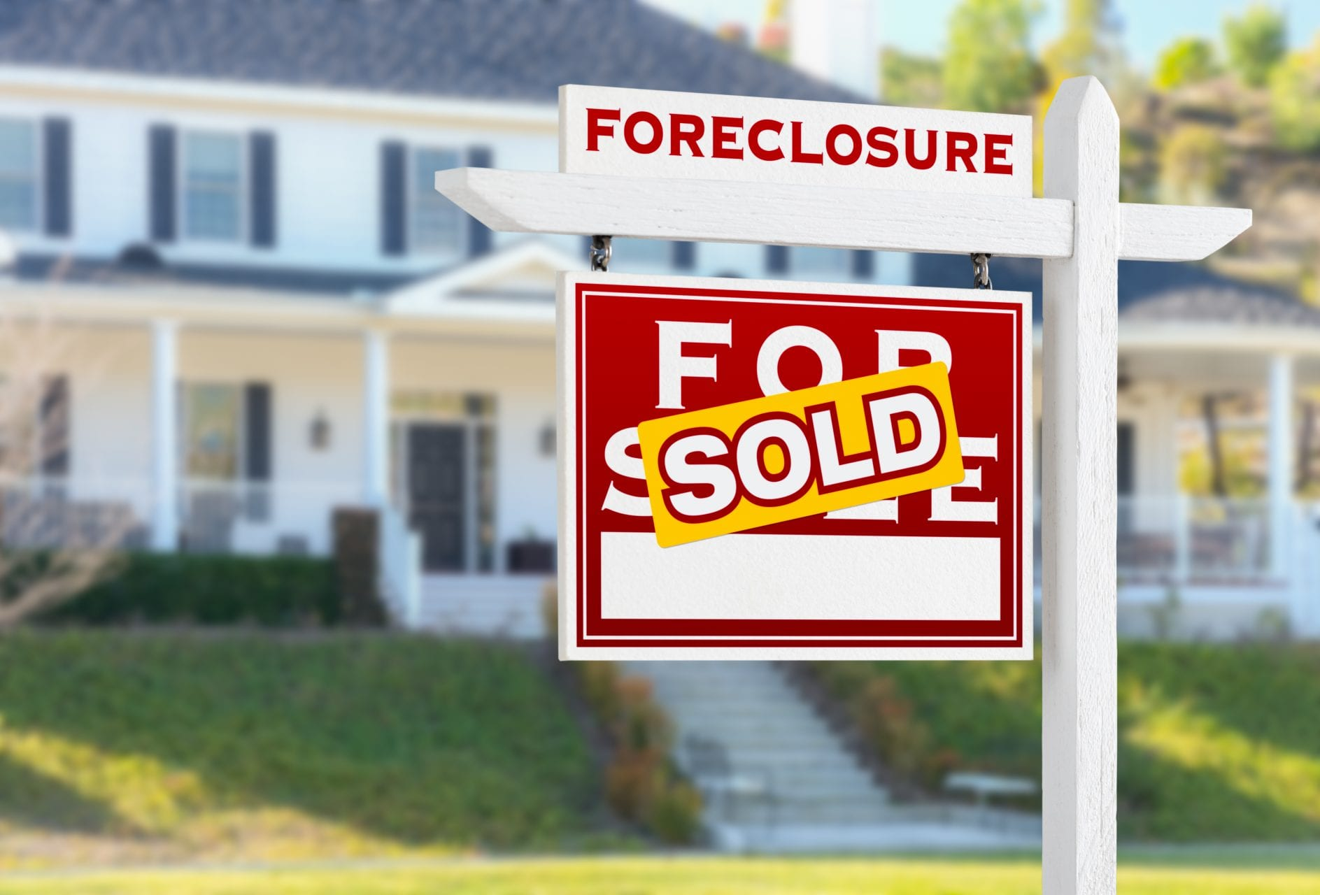Left Facing Foreclosure Sold For Sale Real Estate Sign in Front