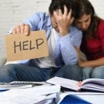Young Couple Worried At Home In Bad Financial Situation Stress A