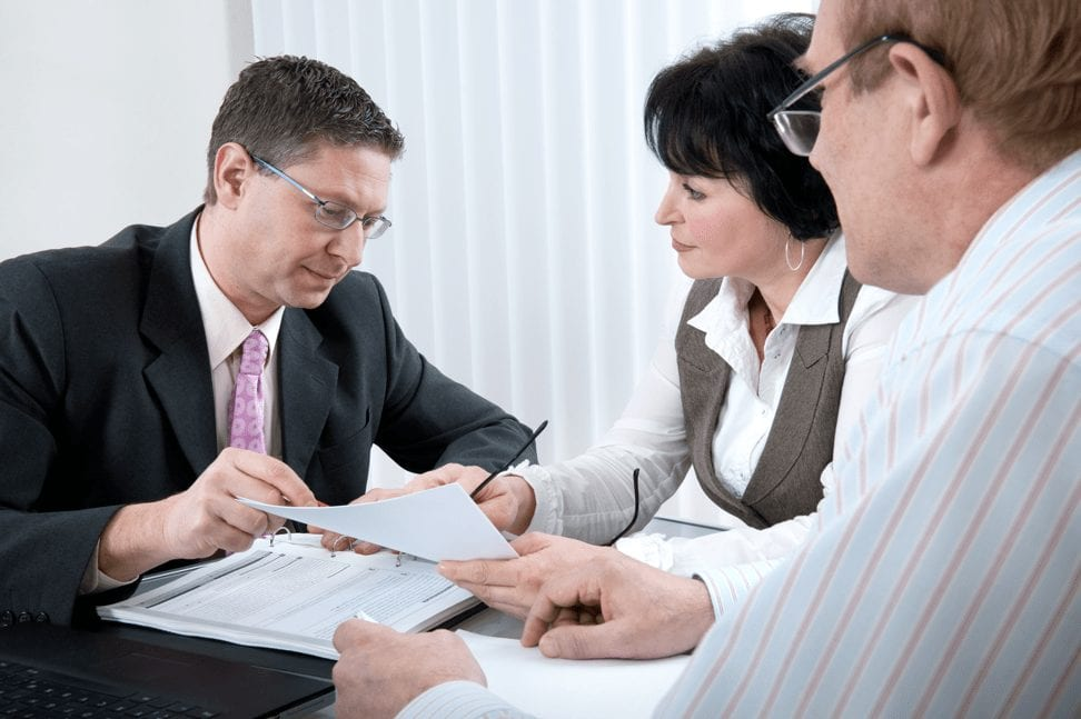 couple going about paperwork with legal consultant