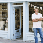 Man in front of small business