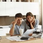 worried-couple-looking-at-bills