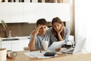 worried-couple-looking-at-bills