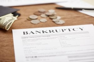 Cost-to-file-bankruptcy-change-100-dollar-bill-bankruptcy-form