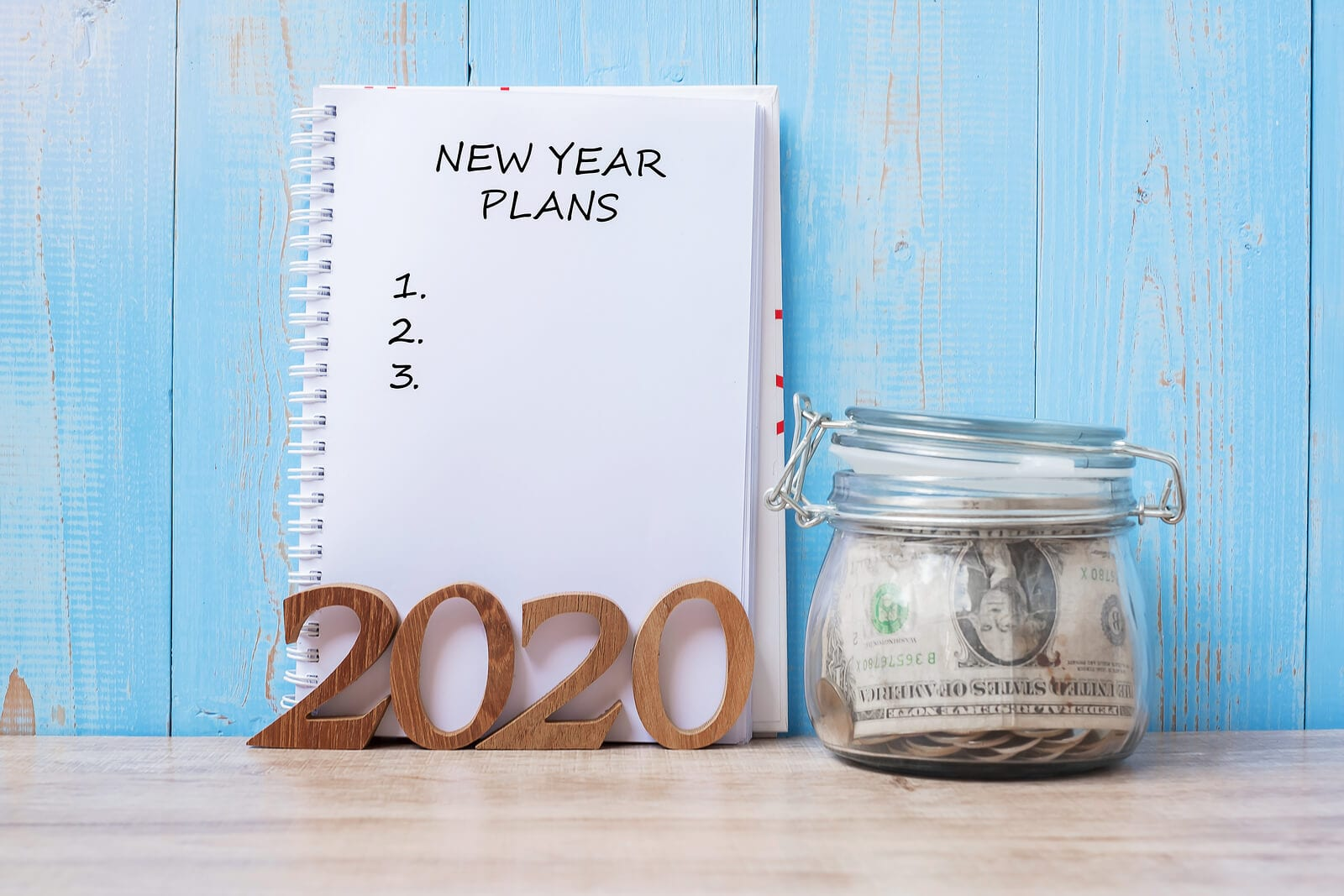 New-Year-Plans-Word-On-Notepad-cash-in-jar