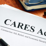 Coronavirus-Aid-Relief-And-Economic-Security-CARES Act-on-desk-with-pen