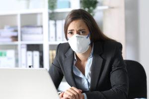 Sad-Executive-Woman-Wearing-mask-learning-about-bankruptcy-coronavirus