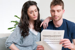 Young-couple-reading-credit-report