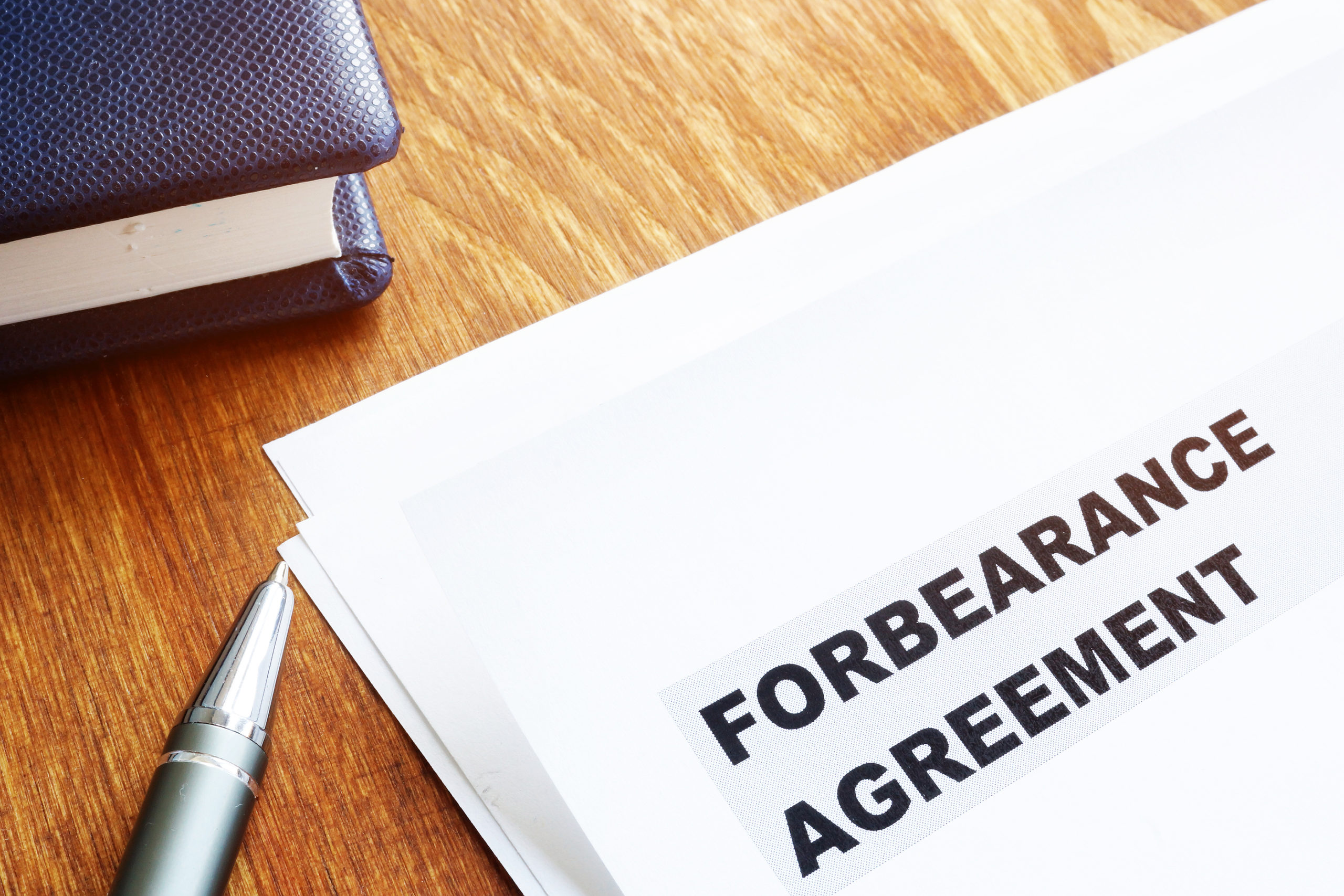 Forbearance-Agreement-Papers-With-Notepad