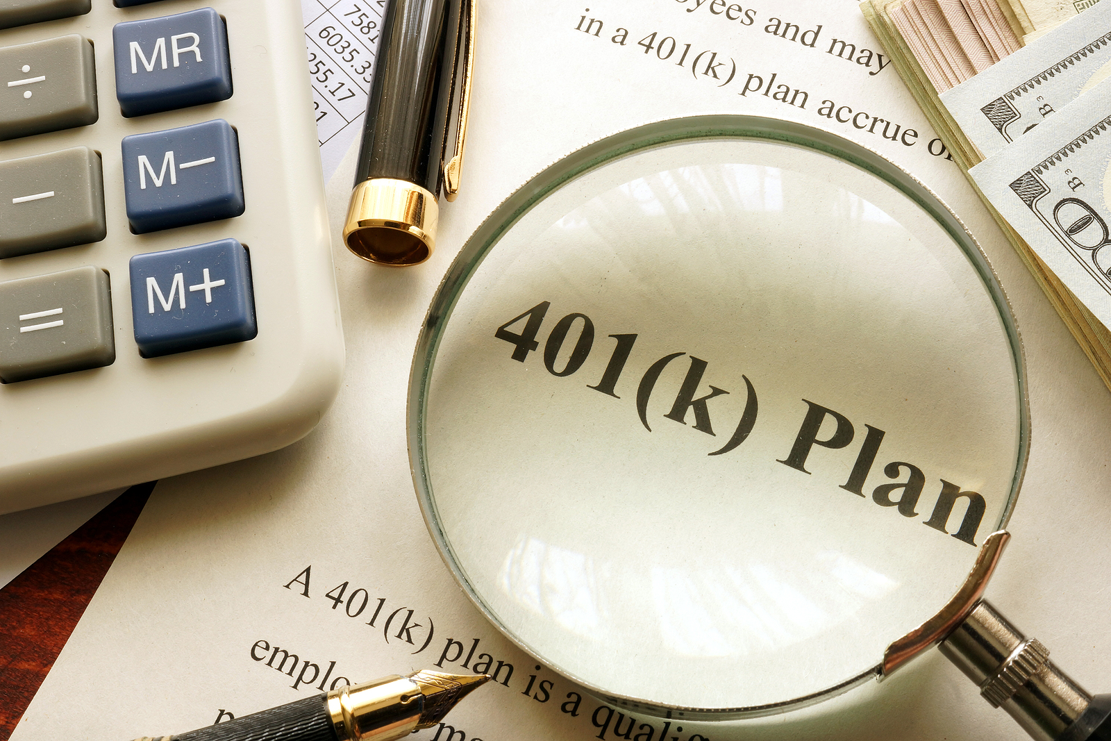Document-with-Title-401k-Plan-on-Table-Under-Magnifying-Glass